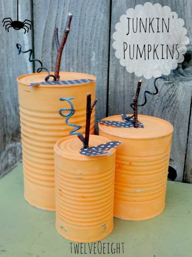 Painting tin can pumpkins